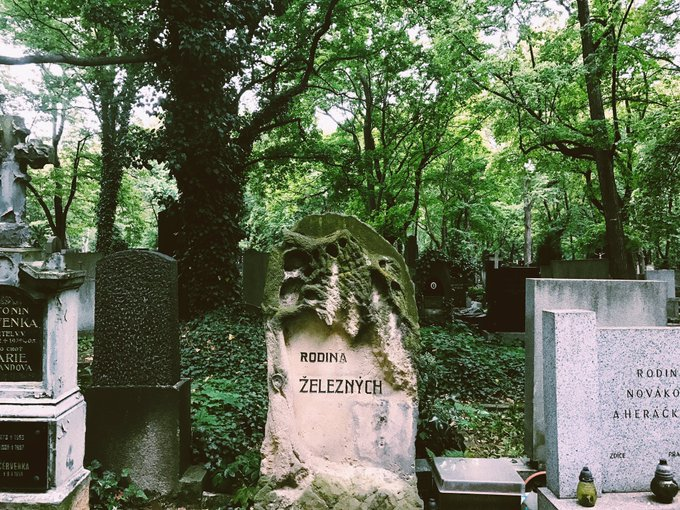 4 pic. Prague's largest cemetery🌿🕯💞 So peaceful, ivy everywhere, flowers, candles lit, rain drizzling💧✨