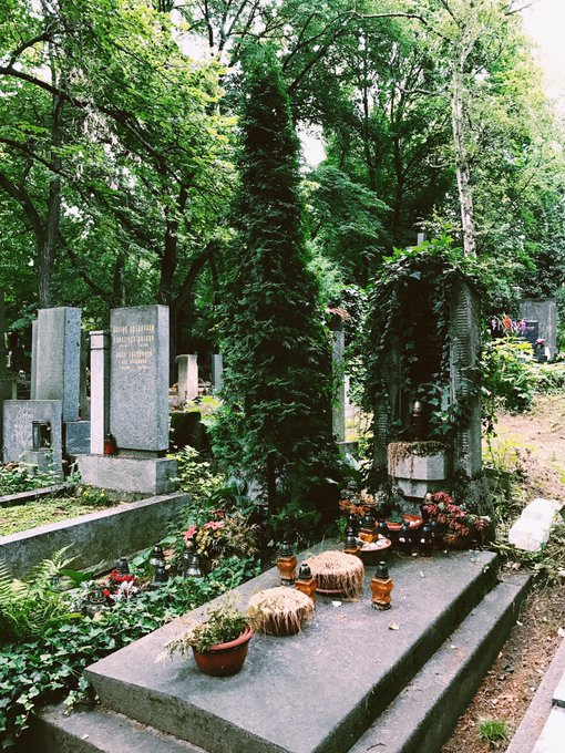2 pic. Prague's largest cemetery🌿🕯💞 So peaceful, ivy everywhere, flowers, candles lit, rain drizzling💧✨
