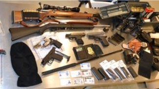 Man accused of impersonating police officer had stash of weapons, officials say