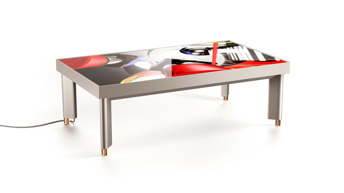 A futuristic table doubles as a digital art display: ://t.