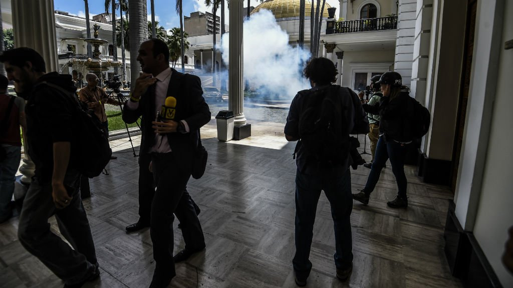 Government supporters rush Venezuela's National Assembly, assault lawmakers