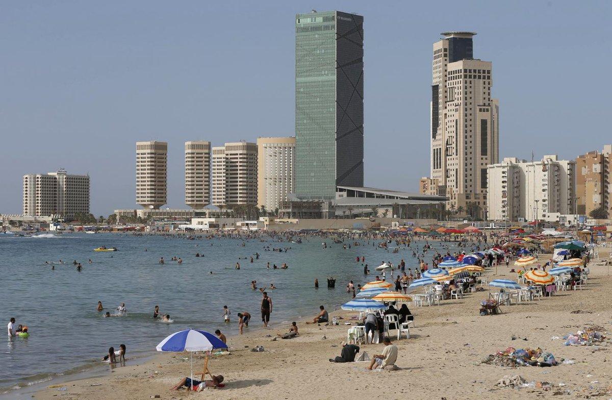 Libya: Shell kills five sunbathers on Tripoli beach as militia airport feud rages