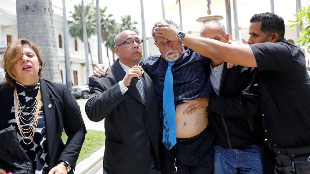 Venezuelan pro-government activists attack Congress members