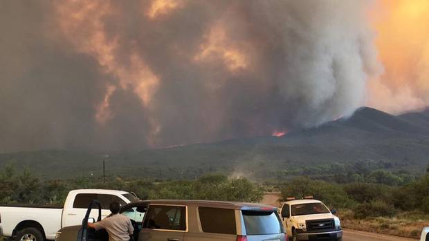 Some Arizona wildfire evacuation orders lifted, weather improves