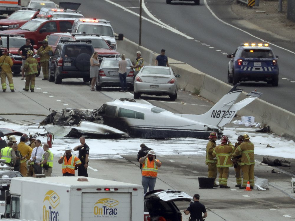 Twin-engine plane crashes into California highway, injuring two