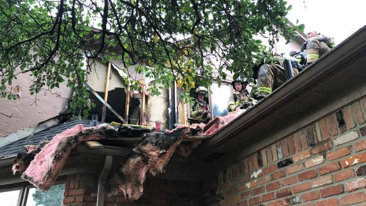 Family escapes house fire possibly caused by lightning strike in West Bloomfield