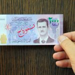 Syria's Assad puts his face on new currency