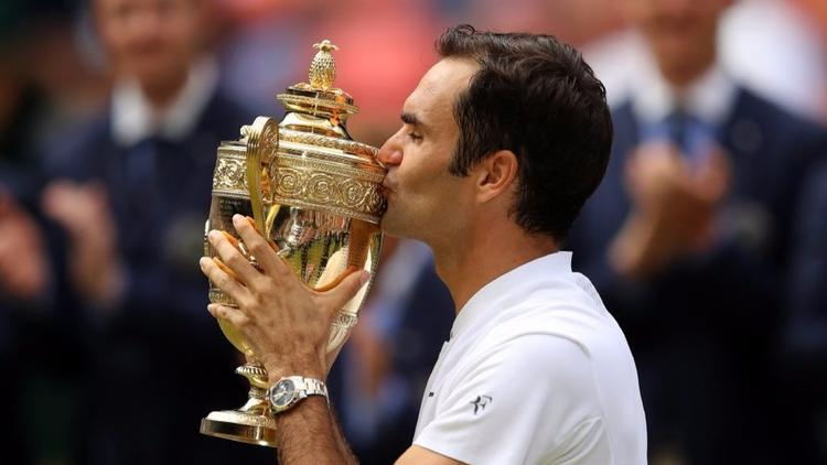 Roger Federer wins record eighth Wimbledon championship https://t.co/U3vkBxHUf8 https://t.co/oooplTgCN9