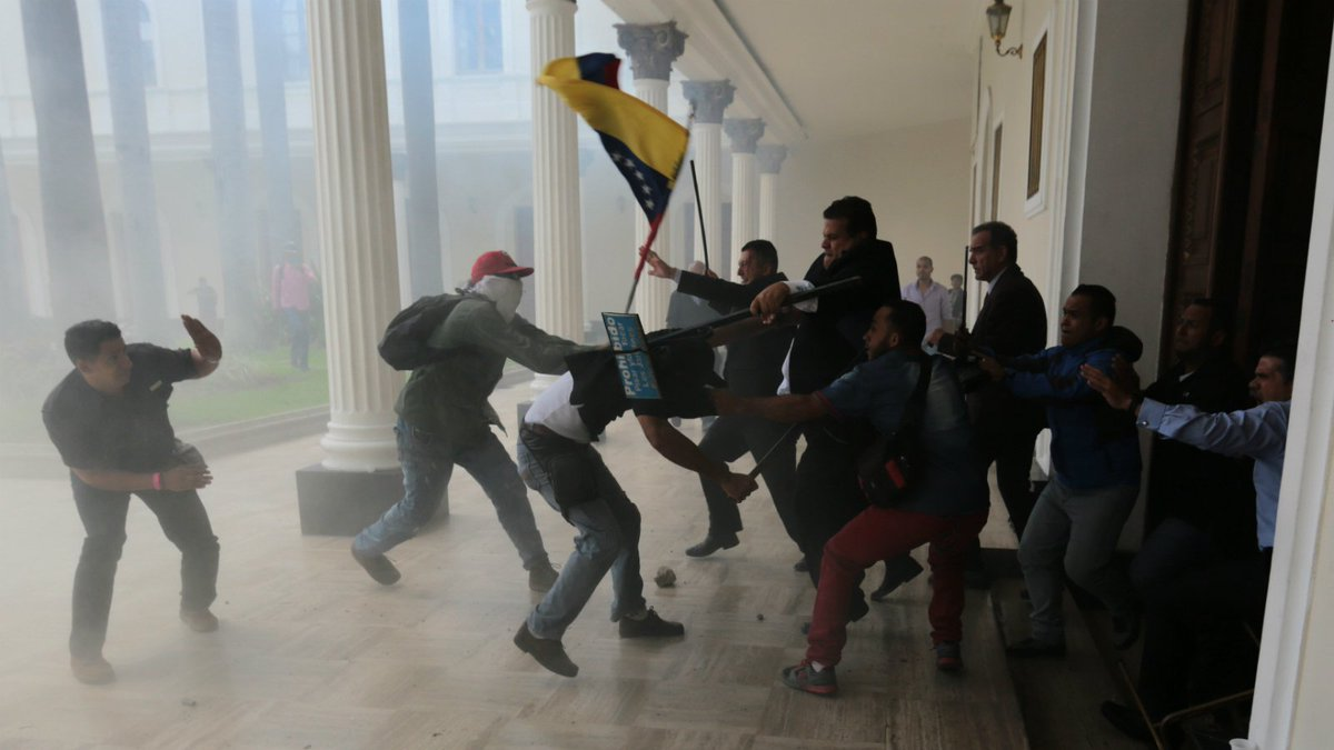 Government supporters storm Venezuela's congress, injuring lawmakers