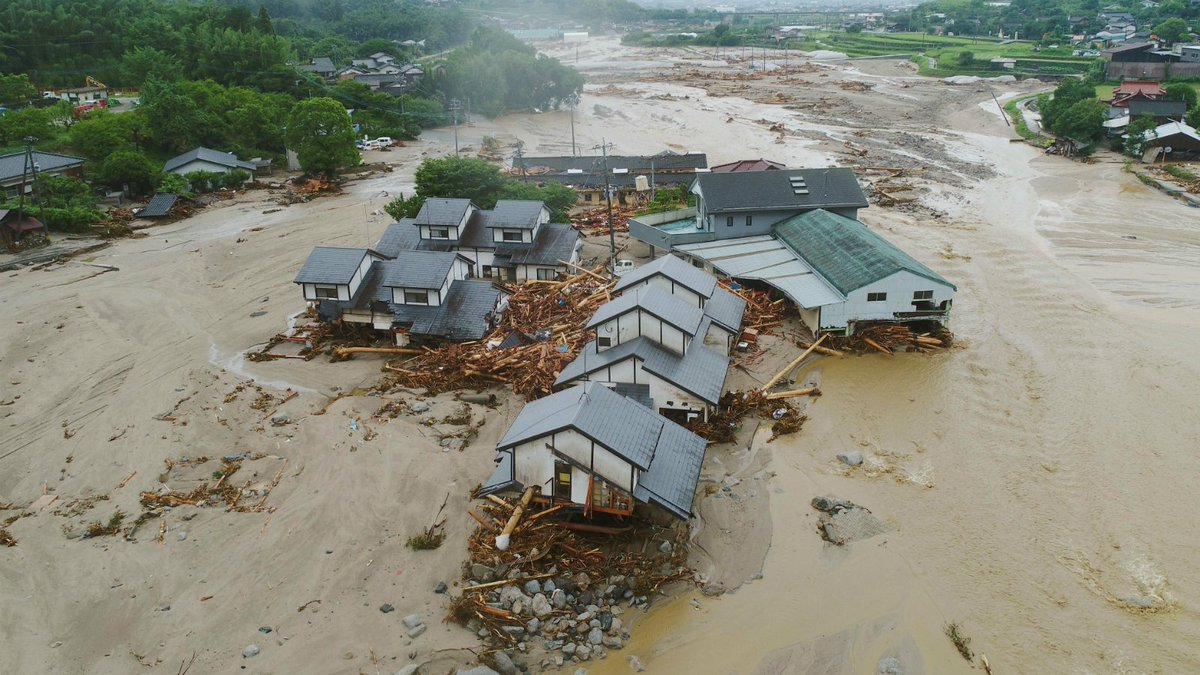 Floods in Japan kill 6 as rescue efforts hampered by mud