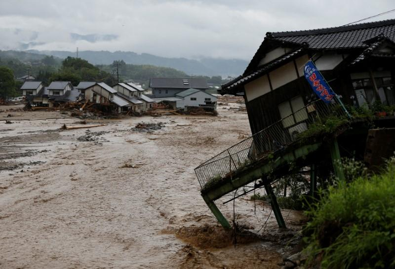 Japan rescuers dig through rubble as rain goes on, at least six dead