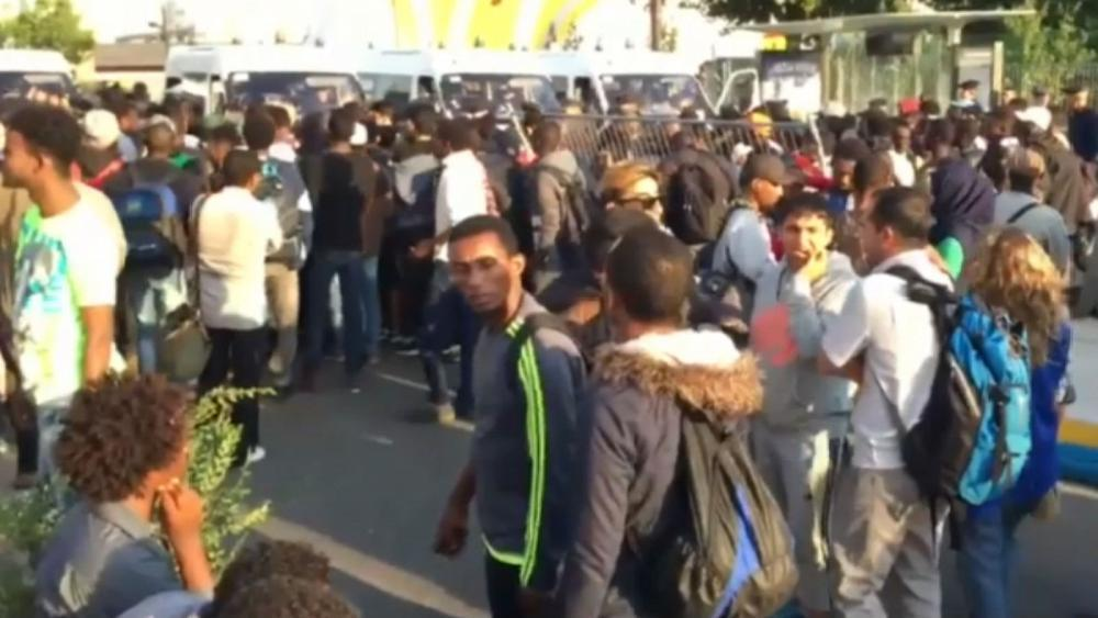 Migrants relocated from Paris makeshift camp to temporary shelters