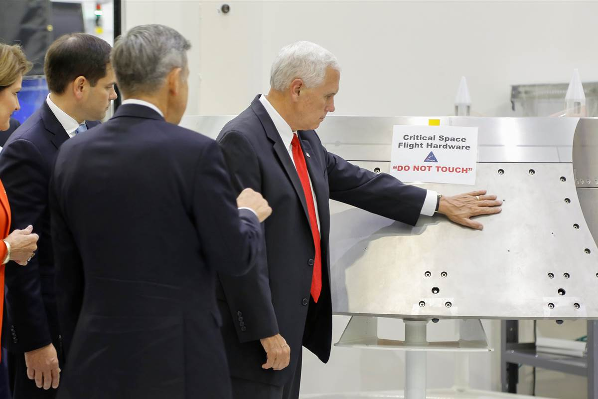 "Photo captures Vice President Mike Pence ignoring NASA's ""Do Not Touch"" sign"