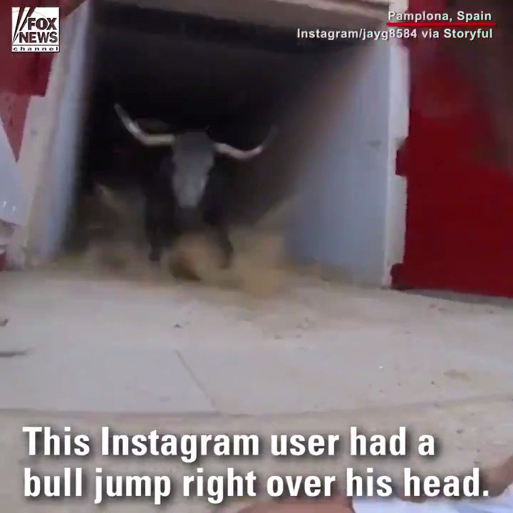 Bull jumps over man's head at San Fermin festival's annual running of the bulls in Spain