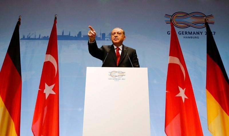 Erdogan says Turkey will respond to any threats on its border