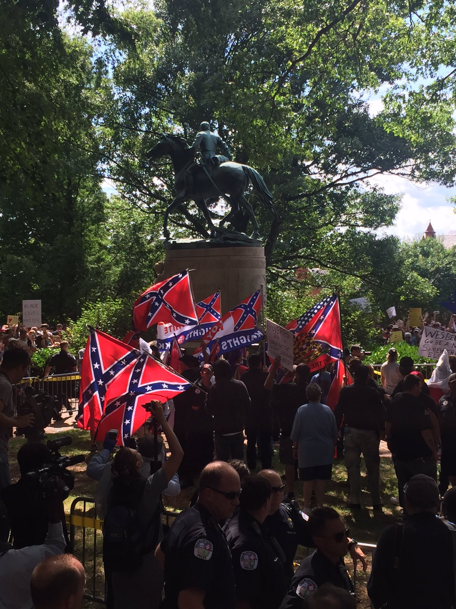 A few dozen KKK members have arrived at rally in Charlottesville to loud boos from hundreds gathered. https://t.co/WfR8fJgQHw