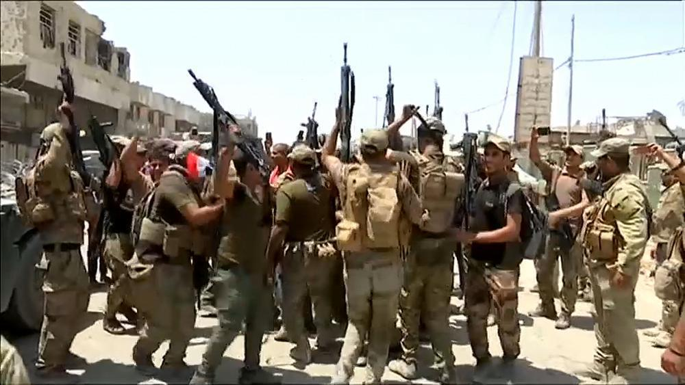 Iraqi forces celebrate driving ISIL from Mosul