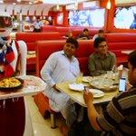 'Robot waitress' draws customers to Pakistani pizza joint
