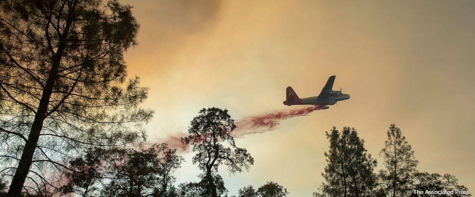 California fires spread quickly; blazes tamed in Colorado