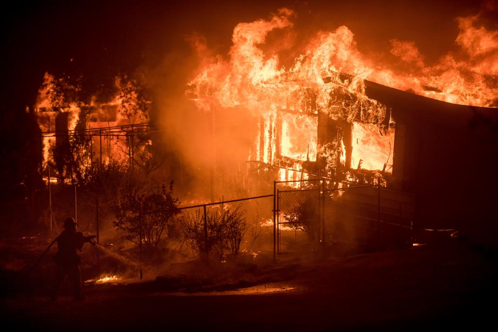 California fires spread quickly, evacuation orders lifted in other parts of West