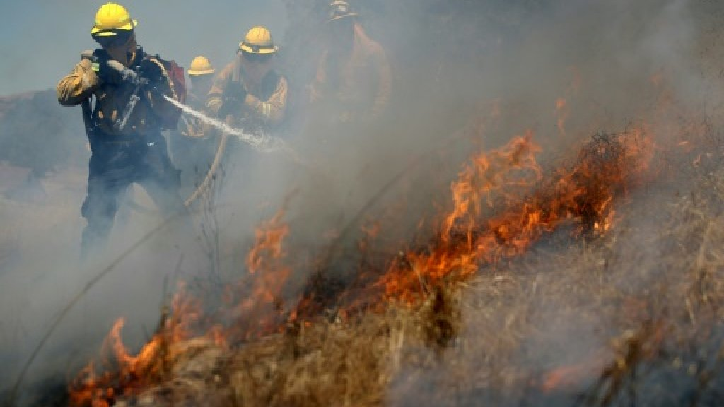 Wildfires rage as California sizzles