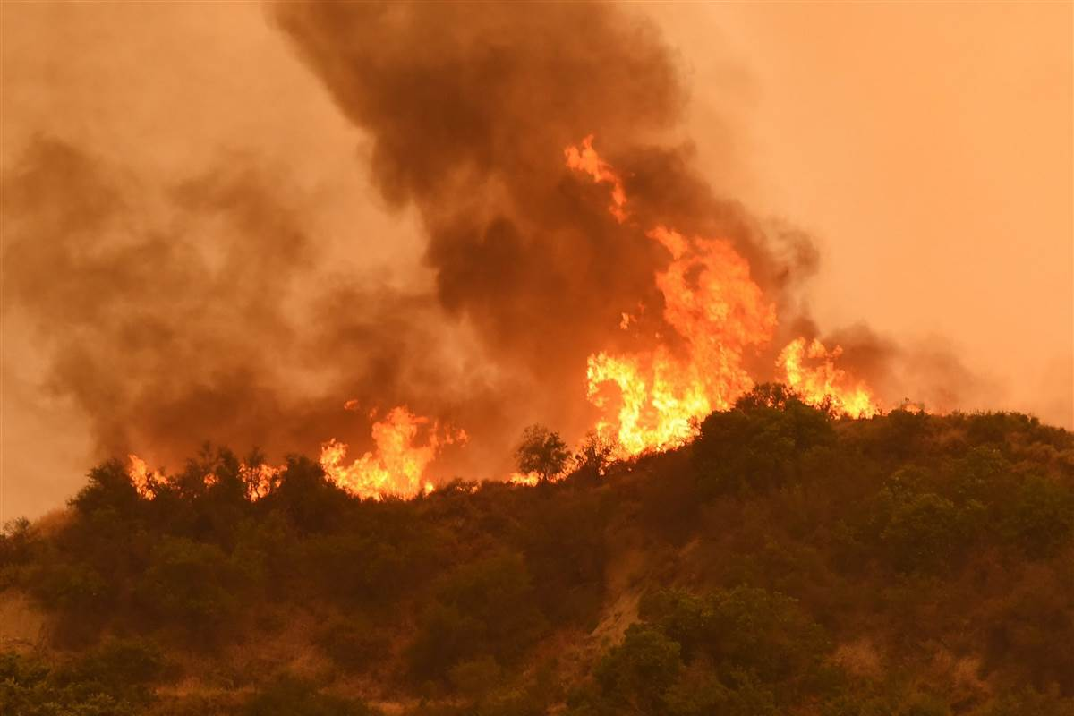 Campers and children evacuated as wildfires spread in California heat wave