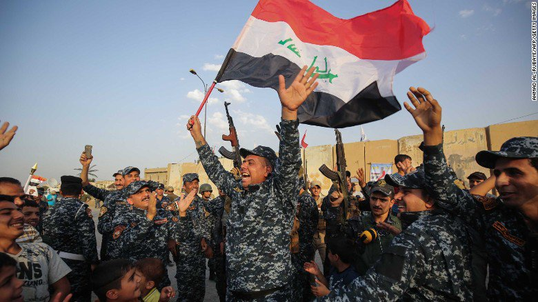 Iraq's prime minister claims Mosul victory, but state TV says ISIS fighters remain