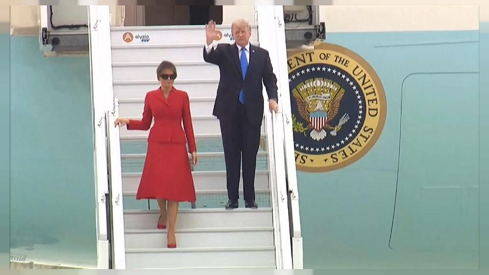 Trump lands in Paris for talks and tourism