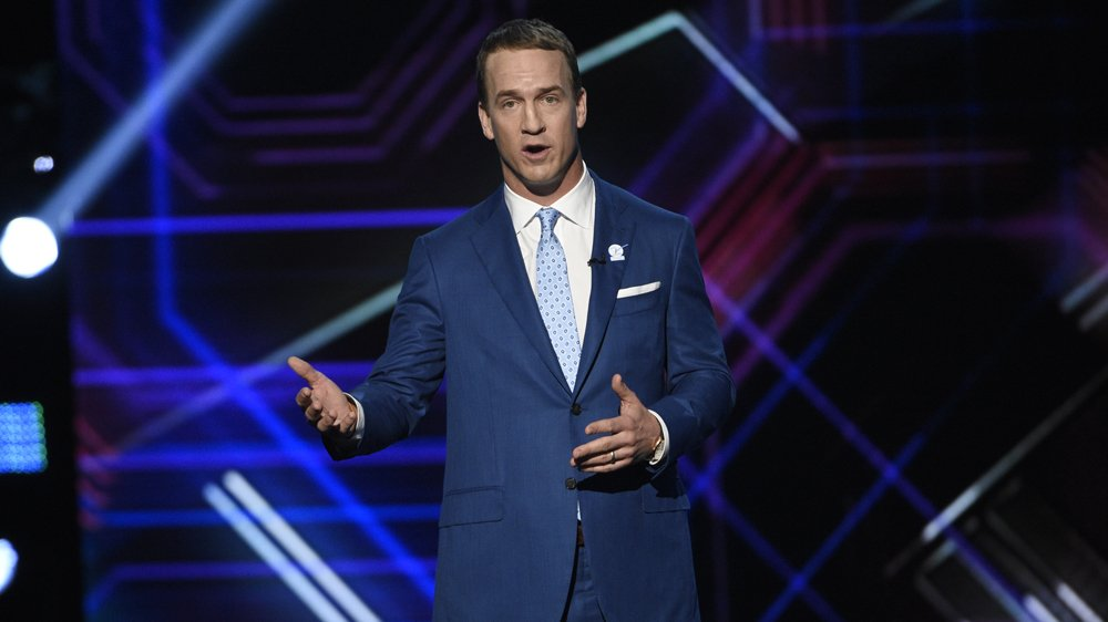 Peyton Manning roasts as host, Michelle Obama promotes inclusion at the