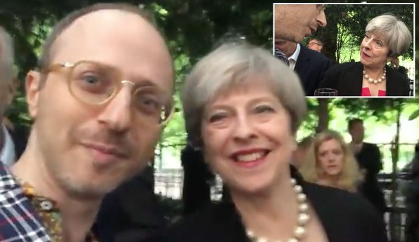 'I'm about to get deported!' Man confronts Theresa May at posh summer party https://t.co/eTiICchZUb https://t.co/STZLBydzXK