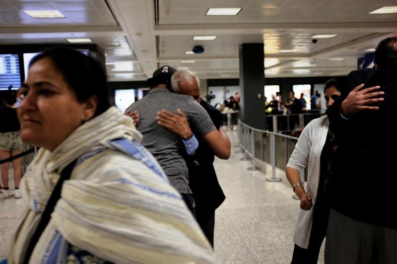 U.S. judge narrows travel ban in defeat for Trump