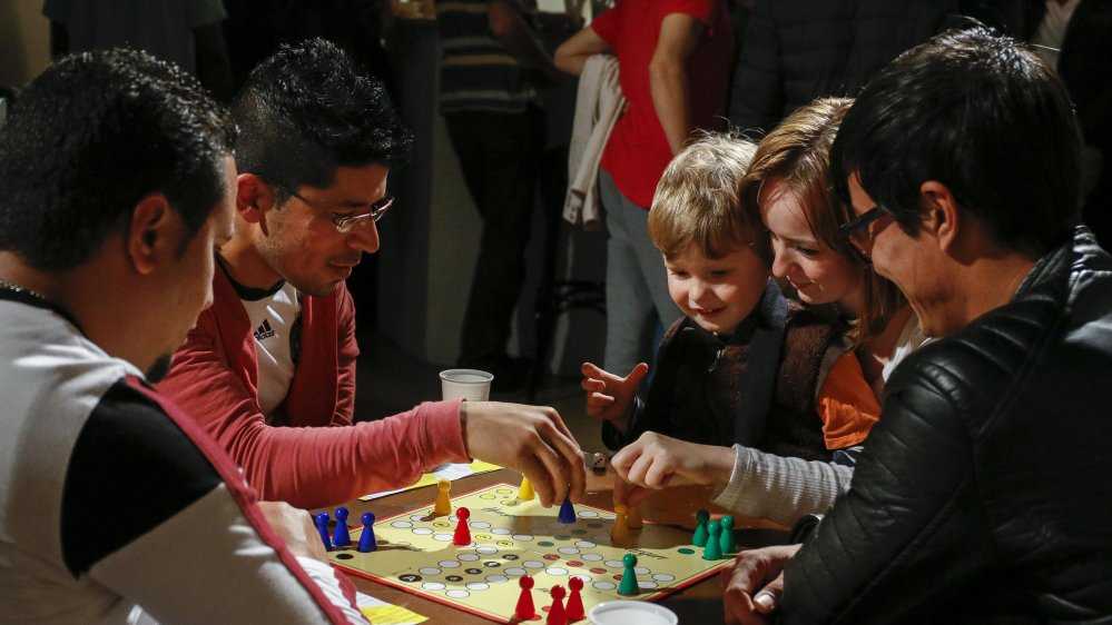"""Refugees welcome. Bring your families.""   Germany's welcome cafes"