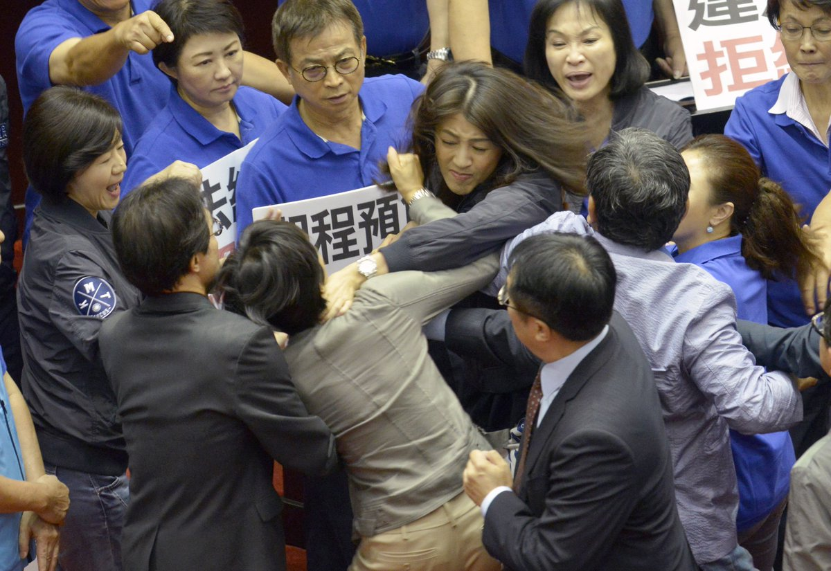 Why can't Taiwan's parliament members stop attacking each other?