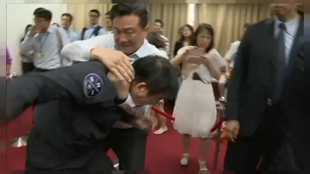 Taiwan's legislators brawl over funding plans
