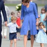 Kate Middleton's got a mini-me! Princess Charlotte matches her mum in cute blue dress as they fly to Berlin