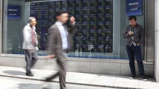 Global stocks edge lower as central banks remain in focus
