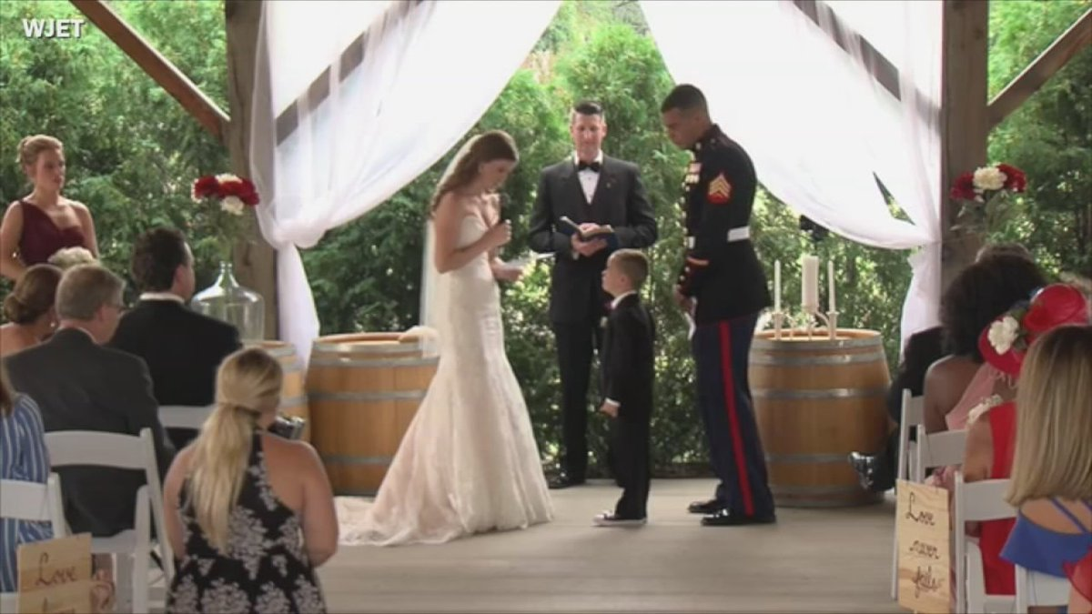 Marine's son cries in new stepmom's arms while couple exchanges vows
