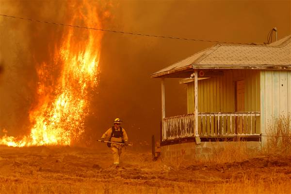 In California, one wildfire is suppressed as another one grows