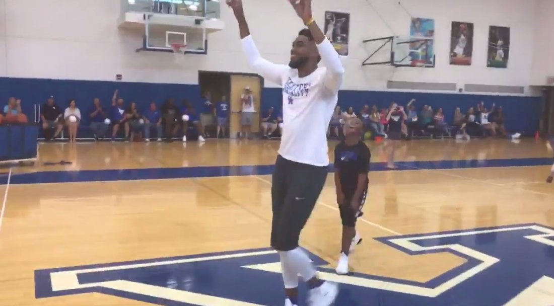 Karl-Anthony Towns Sinks Half-Court Shot to Win a Pair of Nikes for Camper