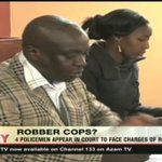 4 Policemen appear in court to face charges of robbery