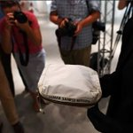 Neil Armstrong's moon dust bag sells for 1.8 mln USD at auction