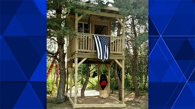 Officers finish tree house for slain state trooper's daughter
