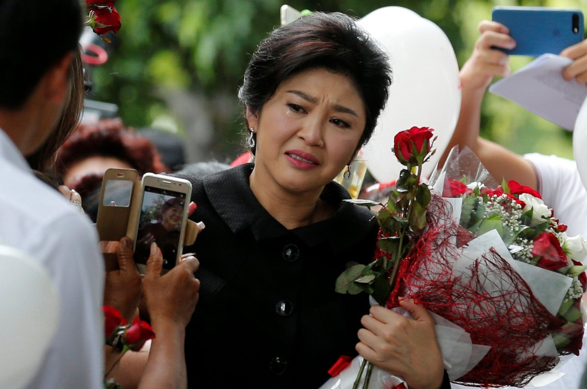 Thailand freezes former PM Yingluck's bank accounts in rice subsidy case