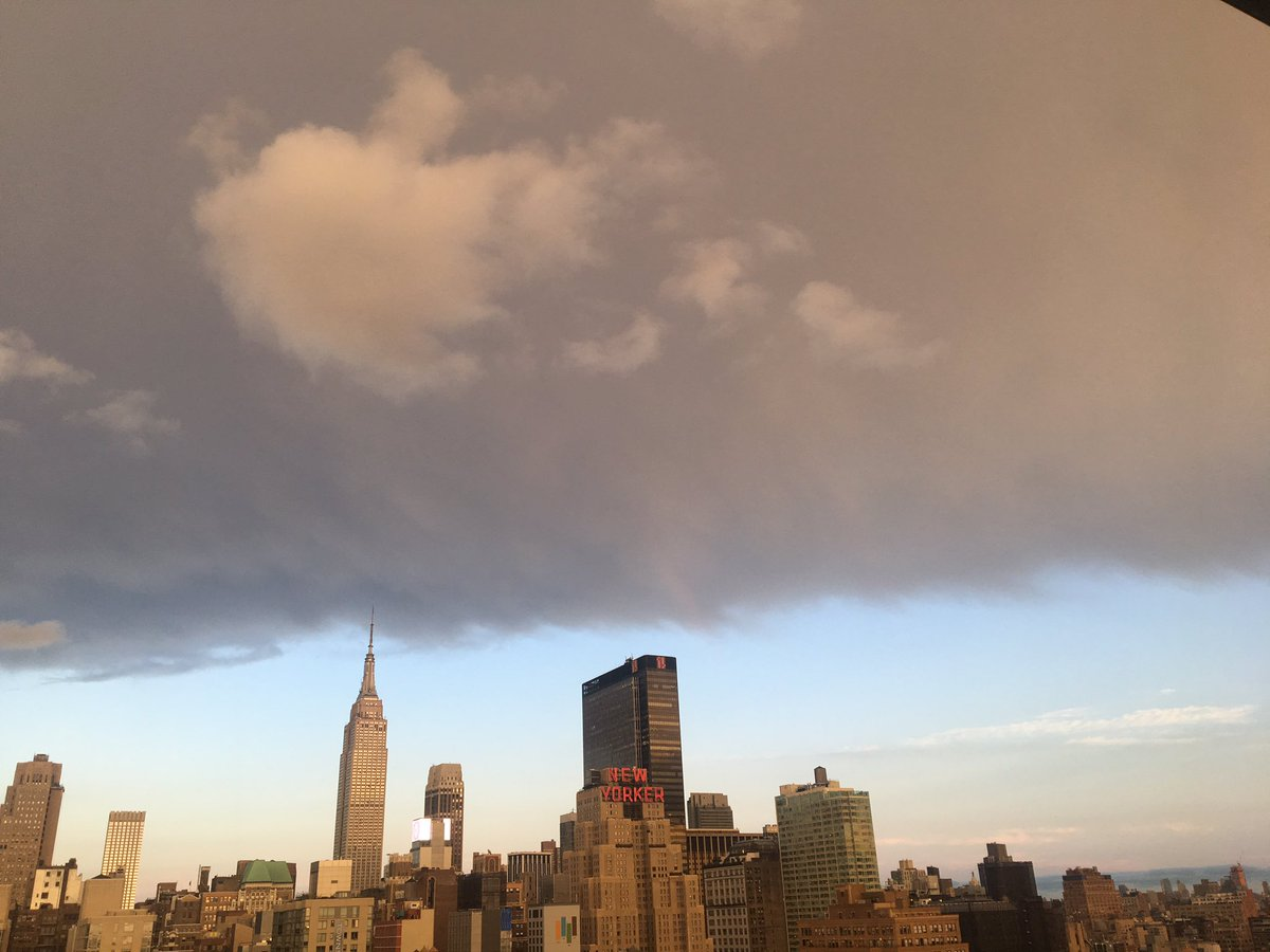 clouds over new york -#main