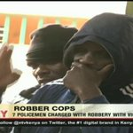 7 policemen charged with robbery with violence
