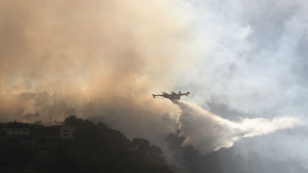 Firefighters continue to battle raging blazes in southern France