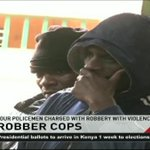 Four policemen charged with robbery with violence