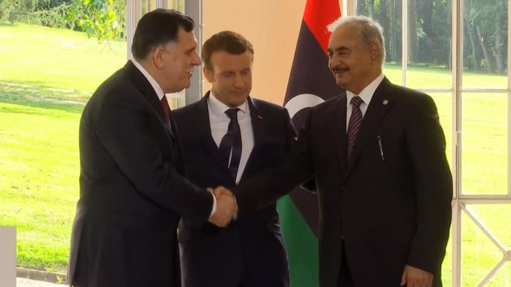 EYE ON AFRICA - Rival Libyan leaders back ceasefire, elections