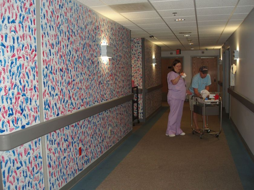Mothers oppose plan to paint over hundreds of baby footprints on Metro East hospital wall