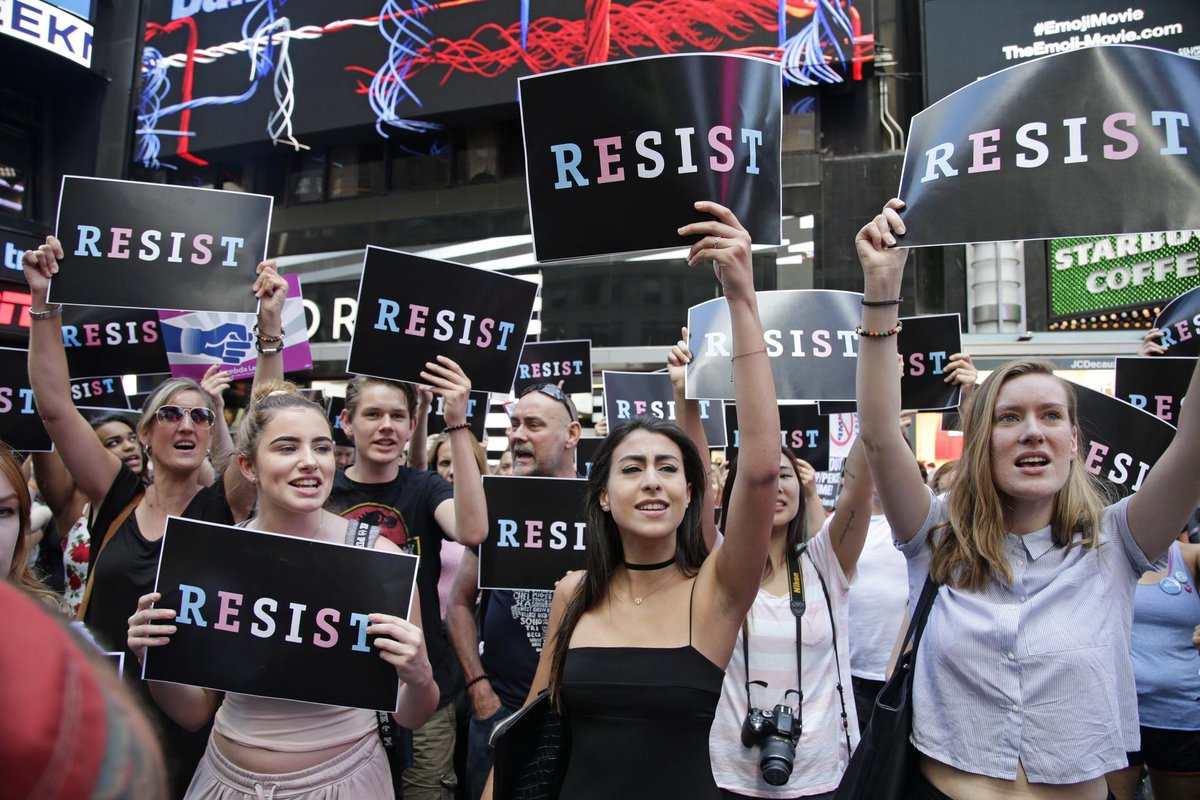 Protesters gather against Trump ban on transgender troops